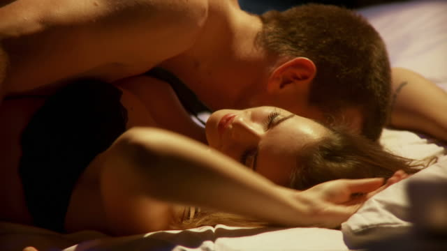 HD DOLLY: Couple Making Love HD1080p: Two DOLLY shots of a young couple passionately making love in their bed in the bedroom. sexual activity sex naked couple stock videos & royalty-free footage
