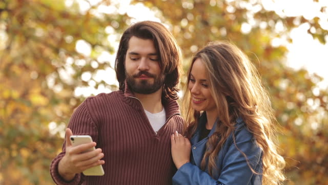 Couple making selfie in the park. video