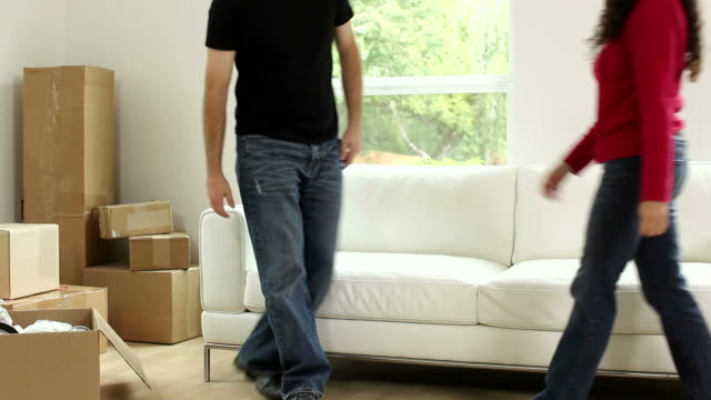 Couple moves couch then sits down video