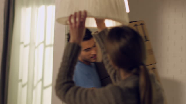 Couple moving in to new apartment video