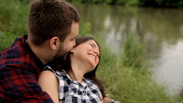 couple near the river smiling video