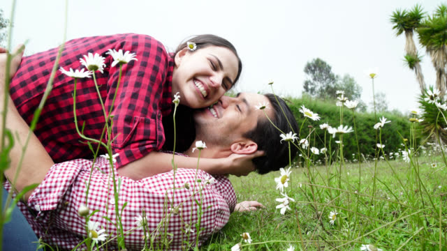 couple of bride and groom kissing in the garden - young couple wedding friends video stock e b–roll