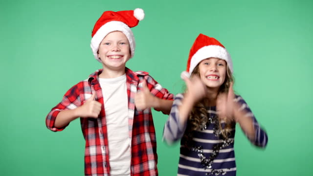 Couple of children in christmas caps video