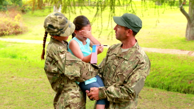 Couple of soldier reunite with their daughter video