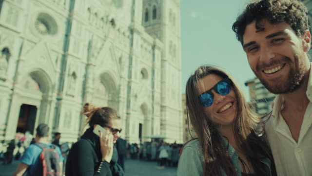Couple of tourists take selfie in Florence, Italy