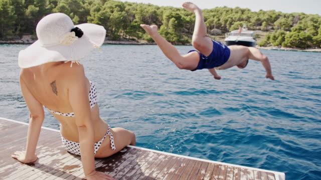 SLO MO Couple on a sailboat video