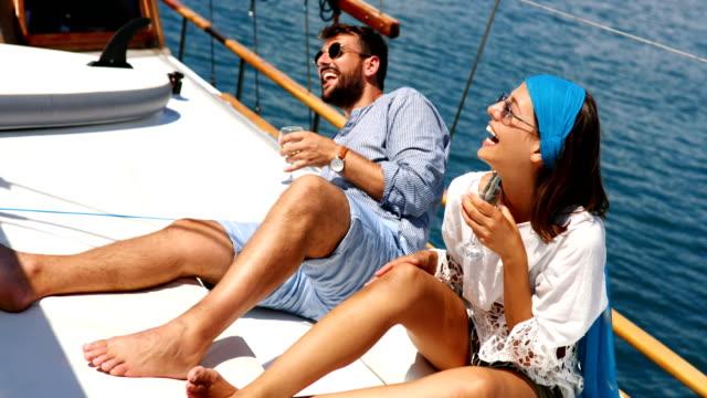 stockvideo's en b-roll-footage met koppel op een zeilboot. - woman very rich