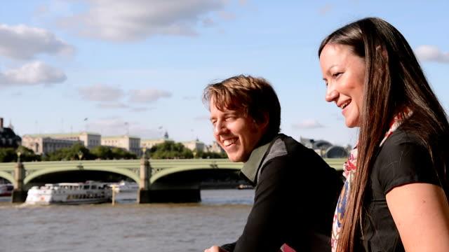 Couple on city break walks down the Thames, London video