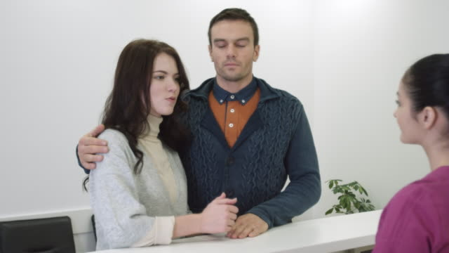 Couple on clinic reception video