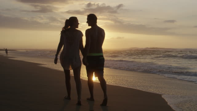 Couple on Honeymoon in Hawaii walking on the Beach video