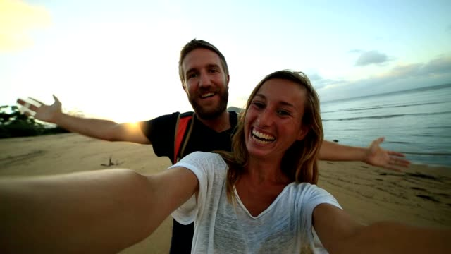 Couple on the beach take selfie portrait video