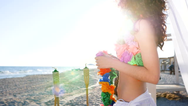 couple on vacation, Hawaii Lei are put on neck of guy and girl, Sunny beach of tropical island for young couple, Sports man and female video