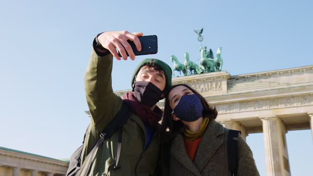 Couple on vacation in Berlin post pandemic