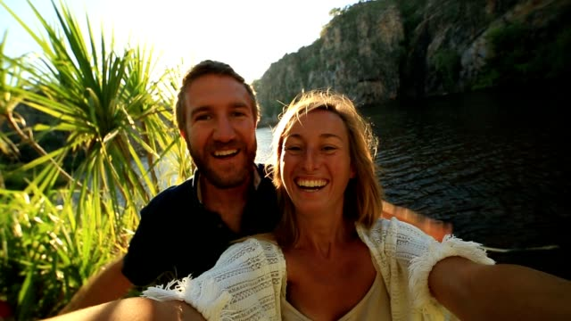 Couple on vacations take selfie portrait video
