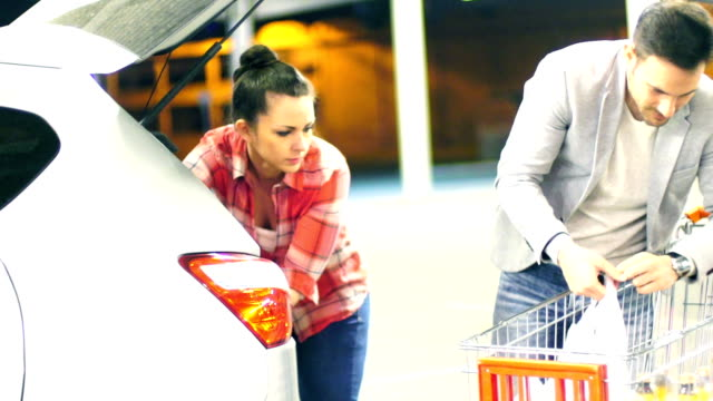 Couple packing their groceries after shopping. video