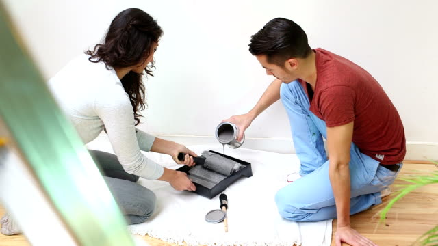 Couple painting in new home video