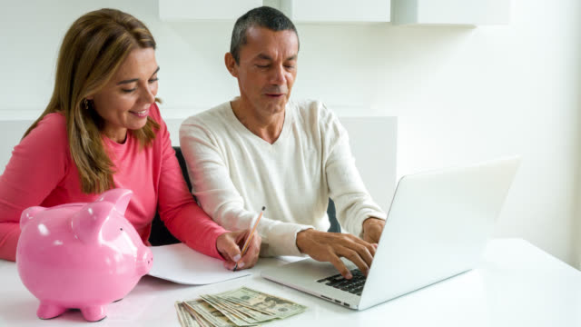 Couple paying bills online video