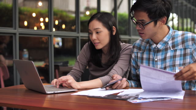 Couple paying Financial bills online on Laptop