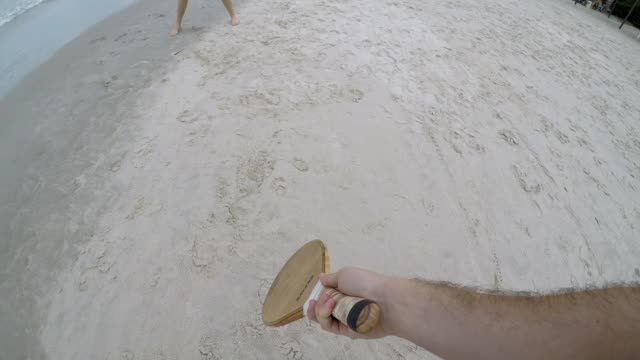 Couple playing Frescobol on the beach video