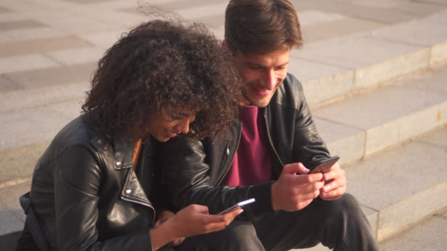 Couple playing games using mobile phones