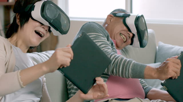 Couple playing with virtual reality headsets video