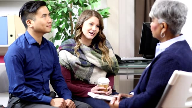 Couple receives counseling from mental health professional. video