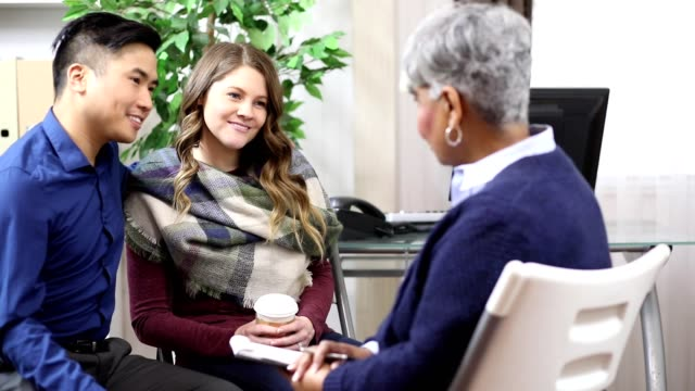 Couple receives counseling from mental health professional.