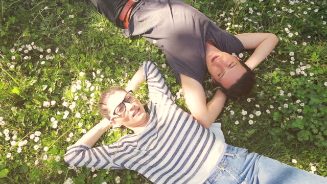Couple relaxing in a beautiful day in nature. video