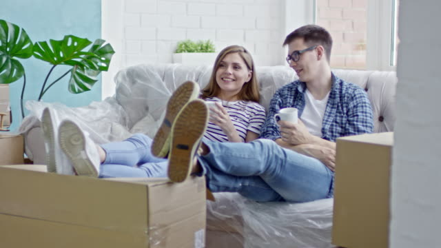Couple Relaxing in New Flat video