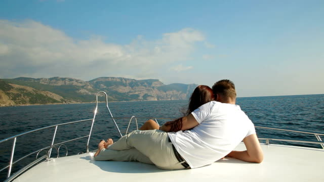 Couple Relaxing on a Speedboat video