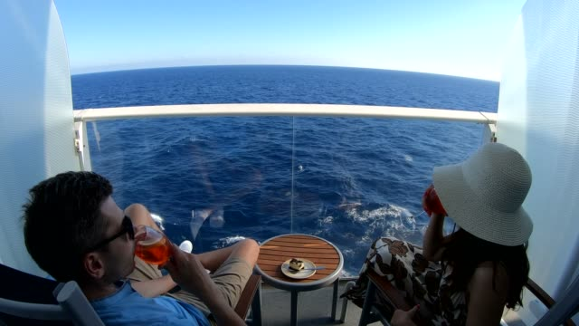 Couple relaxing on the cruise ship balcony at Caribbean Sea