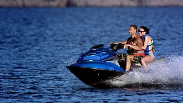 SLO MO Couple Riding A Jet Boat video