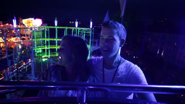 couple riding rollercoaster (part 1/3) - roller coaster stock videos & royalty-free footage