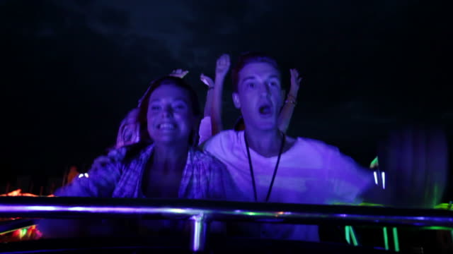 couple riding rollercoaster (part 2/3) - roller coaster stock videos & royalty-free footage