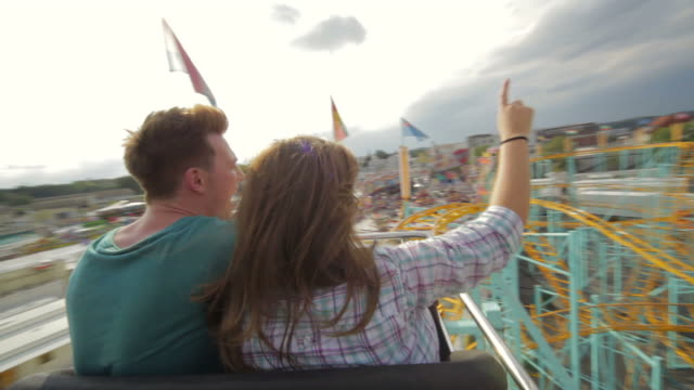 couple riding rollercoaster - roller coaster stock videos & royalty-free footage