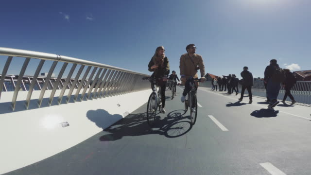 Couple riding urban road city bicycles video