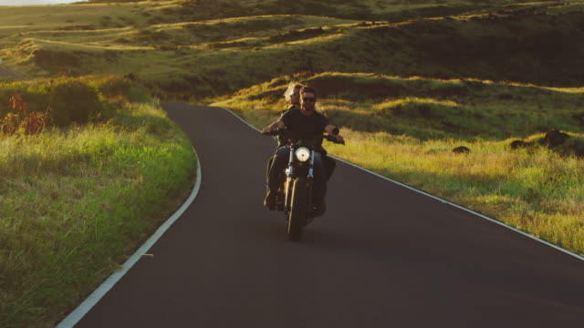 couple riding vintage motorcycle - viaggio su strada video stock e b–roll