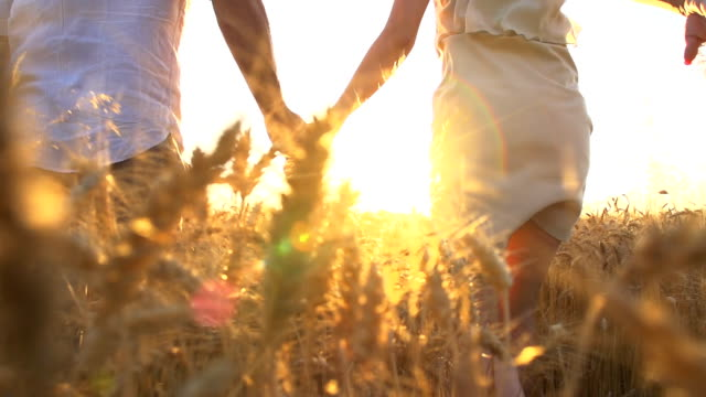 hd super slow-motion: couple running in wheat field - flörta bildbanksvideor och videomaterial från bakom kulisserna
