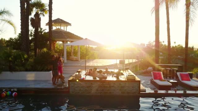 Couple Saying Goodbye at Backyard Pool Party video