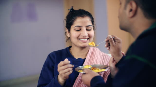 couple sharing and feeding food to each other. - indian food stock videos and b-roll footage
