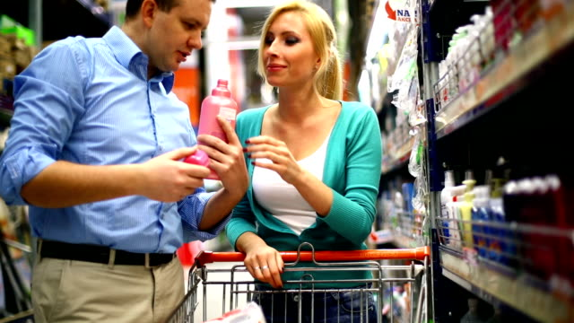 couple shopping in supermarket. - disinfectant stock videos & royalty-free footage