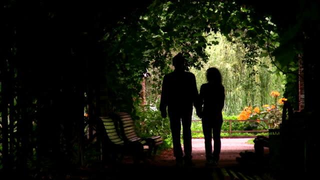 couple silhouette in plant tunnel - abstract silhouette art bildbanksvideor och videomaterial från bakom kulisserna