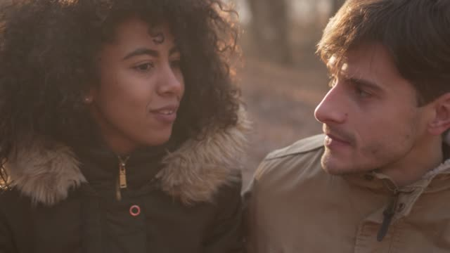 Couple spending time outdoors in winter forest video