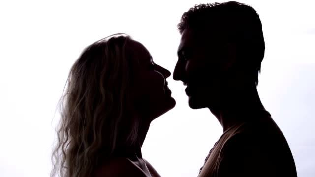 Couple standing and kissing video