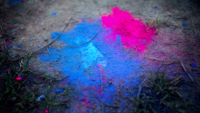 Couple stomping foot on colored powder on the ground SUPER SLO-MO Couple stomping foot on colored powder on the ground stamping feet stock videos & royalty-free footage
