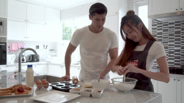Couple sweet cooking together at home. video