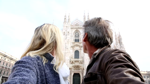 Couple take selfie picture in front of Duomo, Milan, Italy video
