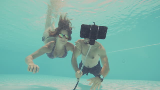 Couple takes a selfie underwater video