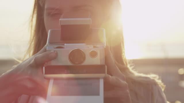 couple taking photos - polaroid stock-videos und b-roll-filmmaterial