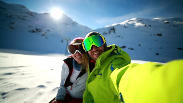 Couple taking selfie on ski slope video